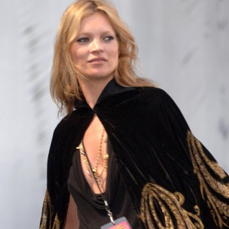 Kate Moss wearing a cape at a festival