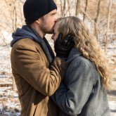Aaron Paul kisses Amanda Seyfried's forehead in snowy forest