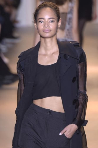 Malaika Firth with natural hair tied back in the John Galliano show, Spring Summer 2016