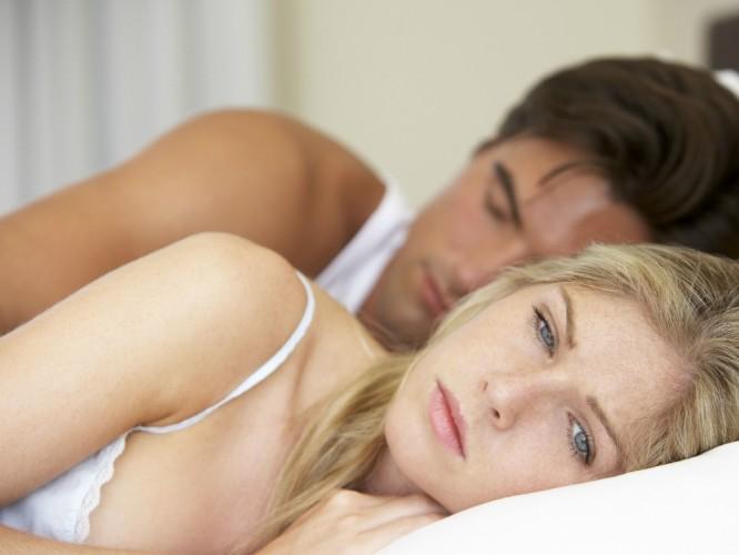 Sad couple in bed landscape.jpg